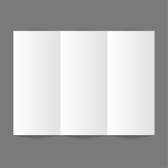 White stationery: blank trifold paper brochure on gray backgroun