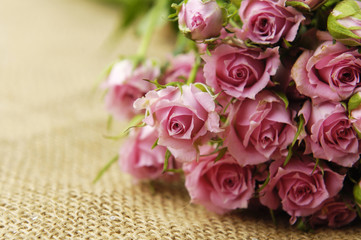 bouquet Roses on sackcloth textured background