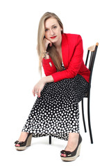 Yong woman in classic Retro Polka Dot Dress and red coat isolate