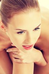 Beautiful topless woman with fresh clean skin.