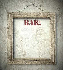 Bar menu in old wooden frame on wall