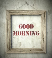 Good morning emblem in old wooden frame on wall