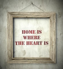 Home is where the heart is in old wooden frame