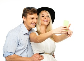Beautiful smiling young couple making selfie