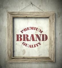 Premium brand emblem in old wooden frame