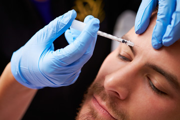 Man Having Cosmetic Injection Treatment at Beauty Clinic