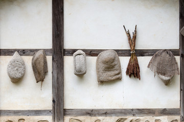 Vegetables drying on a house wall