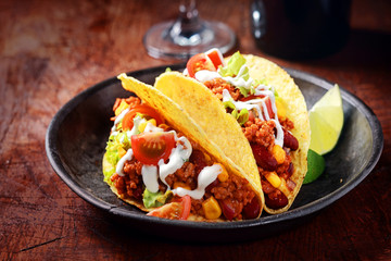 Delicious spicy tacos with meat and vegetables