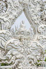 white buddha statue in the white temple, Thailand