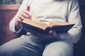 Man fliping through big book