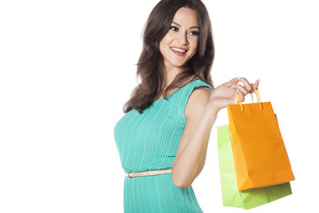 smiling beautiful girl with the shopping bags in her hand