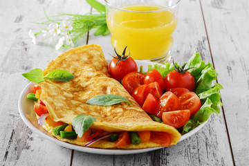 Aluminium Prints Egg omelet with vegetables and cherry tomatoes