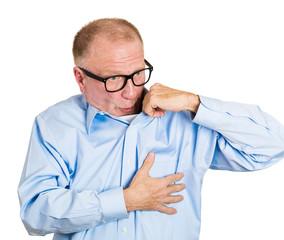 Is that me? Senior elderly man blowing air venting his shirt