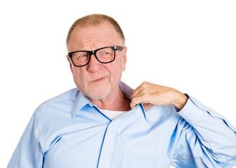 Portrait of senior man in Awkward situation, white background