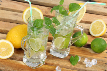 Drink with lime, lemon and ice