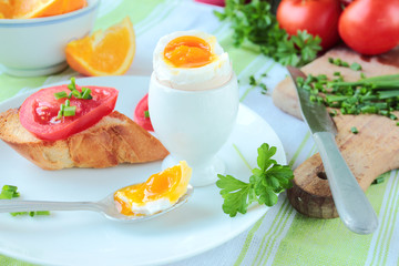 Boiled egg for breakfast with fresh vegetables