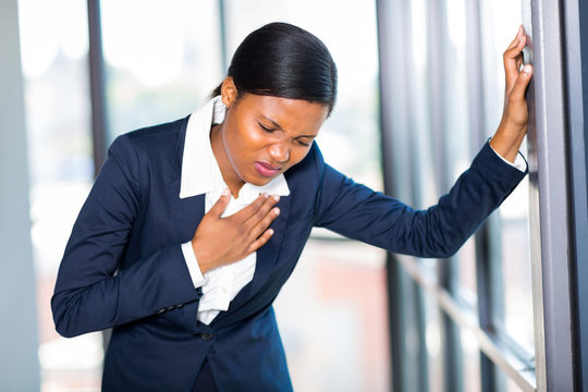 young african american businesswoman having heart attack