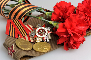 Soviet military cap, flowers, Saint George ribbon, medals of Gre
