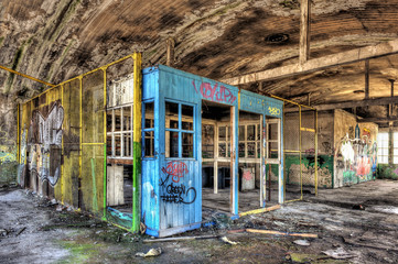 Dilapidated office booth in an abandoned factory