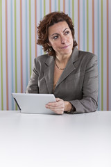 Businesswoman using a digital tablet