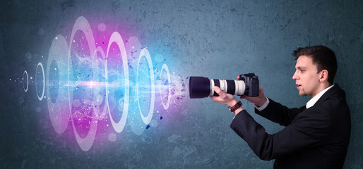 Photographer making photos with powerful light beam