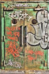 Vandalized lift door in an abandoned factory