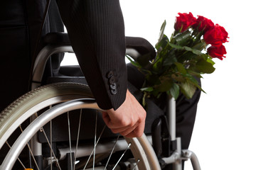 Disabled man with bouquet of flowers