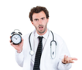 Stressed Busy doctor holding alarm clock on white background