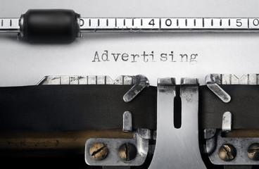 """""""Advertising"""" written on an old typewriter"""