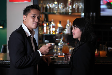 Photograph of couple relaxing at bar or lounge
