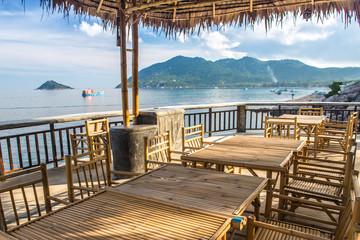 Wooden table in sea seaside restuarant
