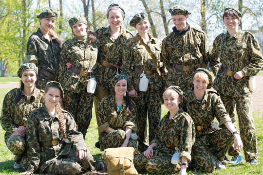 Group of military women and man together outdoor