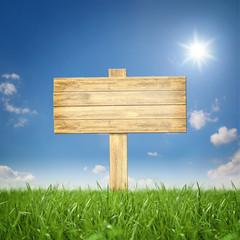 Fototapete - Holzschild in der Landschaft
