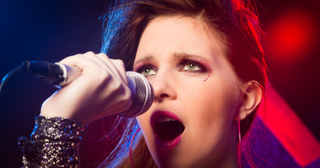 Pop star singing on stage