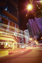 Road light trails on modern city buildings backgrounds in HongKo