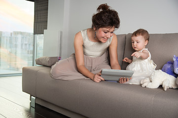 Mother and daughter with touchscreen device
