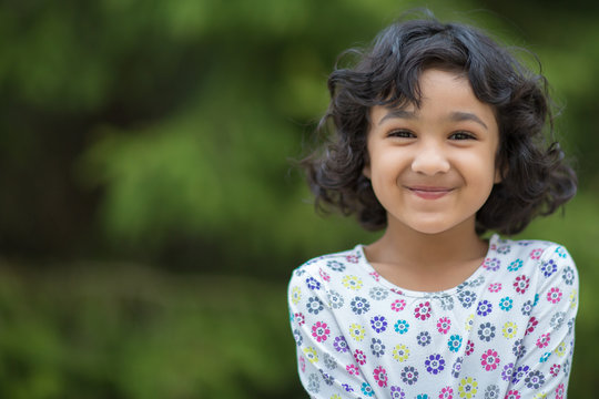 Outdoor Portrait of a Smiling Little Girl