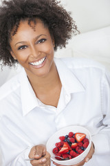 Mixed Race African American Woman Eating Fruit