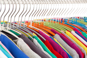 Collection of colored shirts on steel hangers