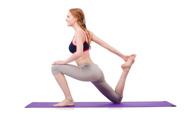 Young female doing exercises on white