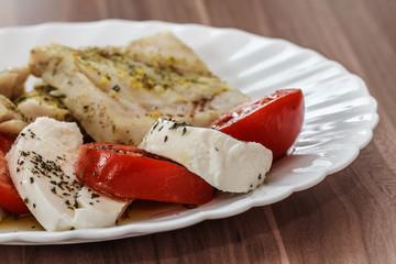 roasted fish and Italian caprese salad
