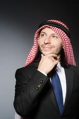 Arab businessman againt grey background