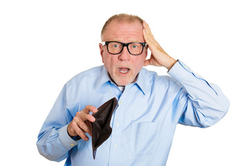 Sad, gloomy, surprised elderly man holding empty wallet