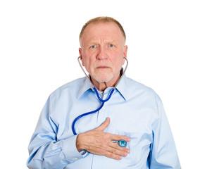 geriatric care, senior old elderly man listening his heart