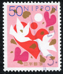 stamp printed by Japan shows Hearts and Doves