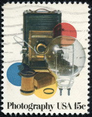 stamp printed in USA shows vinatge photocamera and acsessores