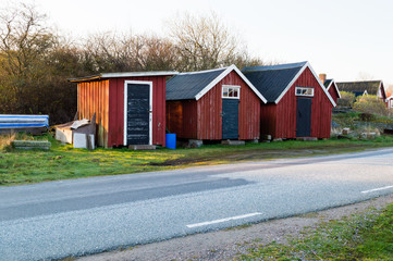 Boathouses by the road