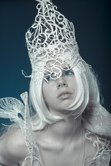 Snow white Queen. Beautiful model with long white hair and vinta