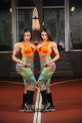 beautiful woman on the gym posing