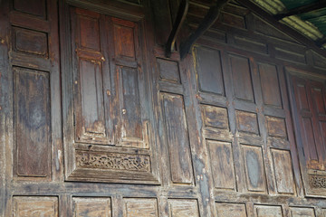Old wooden windows with floral pattern